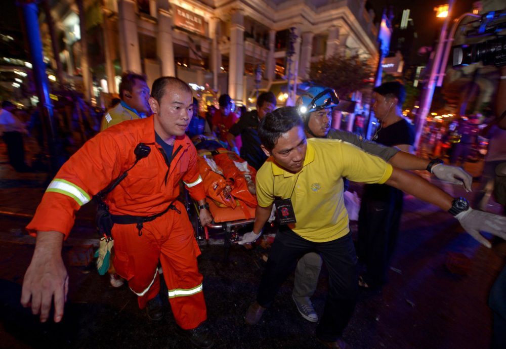Rescue workers carry an injured person after a bomb exploded outside a religious shrine in central Bangkok late on August 17, 2015. (Pornchai Kittiwongsakul/AFP/Getty Images)