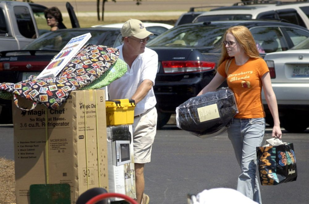 Duval McDaniel from Katy, Texas, helps his daughter, Darby, a then Ole Miss freshman, move into Stockard-Martin Hall on the Oxford campus of The University of Mississippi in this Aug.19, 2004, photo. (Kevin Bain/AP)