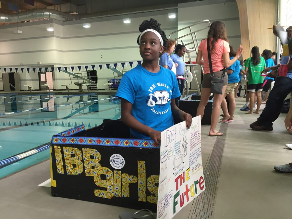 Dozens of teenage girls from Chavez High School built cardboard boats for a regatta. (Houston Public Media)