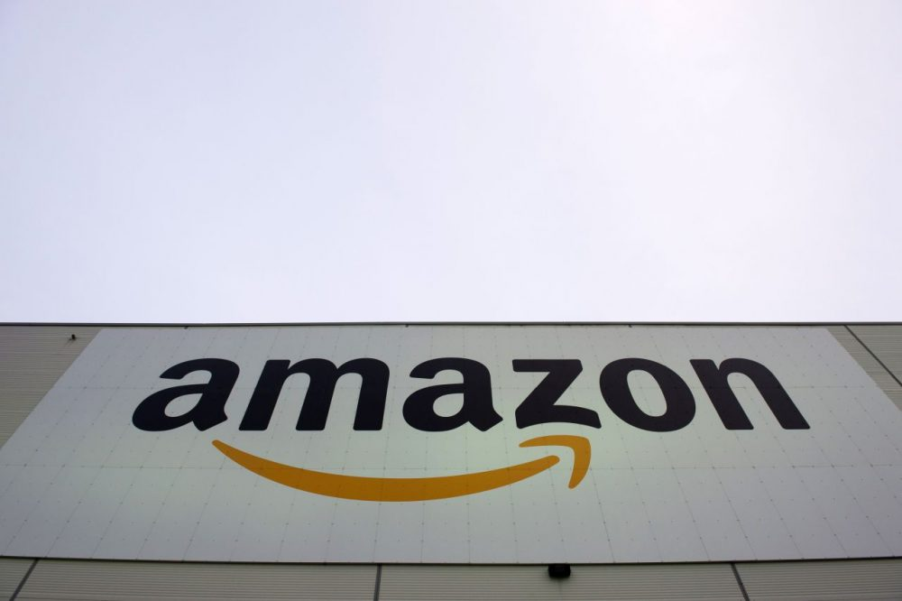 The logo of U.S. online retail giant Amazon is displayed on the Brieselang logistics center, west of Berlin on November 11, 2014. (John MacDougall/AFP/Getty Images)