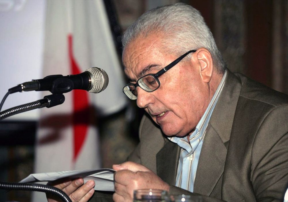 In this undated photo released Tuesday, Aug. 18, 2015 by the Syrian official news agency SANA, one of Syria's most prominent antiquities scholars, Khaled al-Asaad, speaks in Syria. Islamic State militants beheaded al-Asaad in the ancient town of Palmyra, Syria, then strapped his body to one of the town's Roman columns, Syrian state media and an activist group said Wednesday. The killing of 81-year-old al-Asaad was the latest atrocity perpetrated by the militant group, which has captured a third of both Syria and Iraq. (SANA via AP)