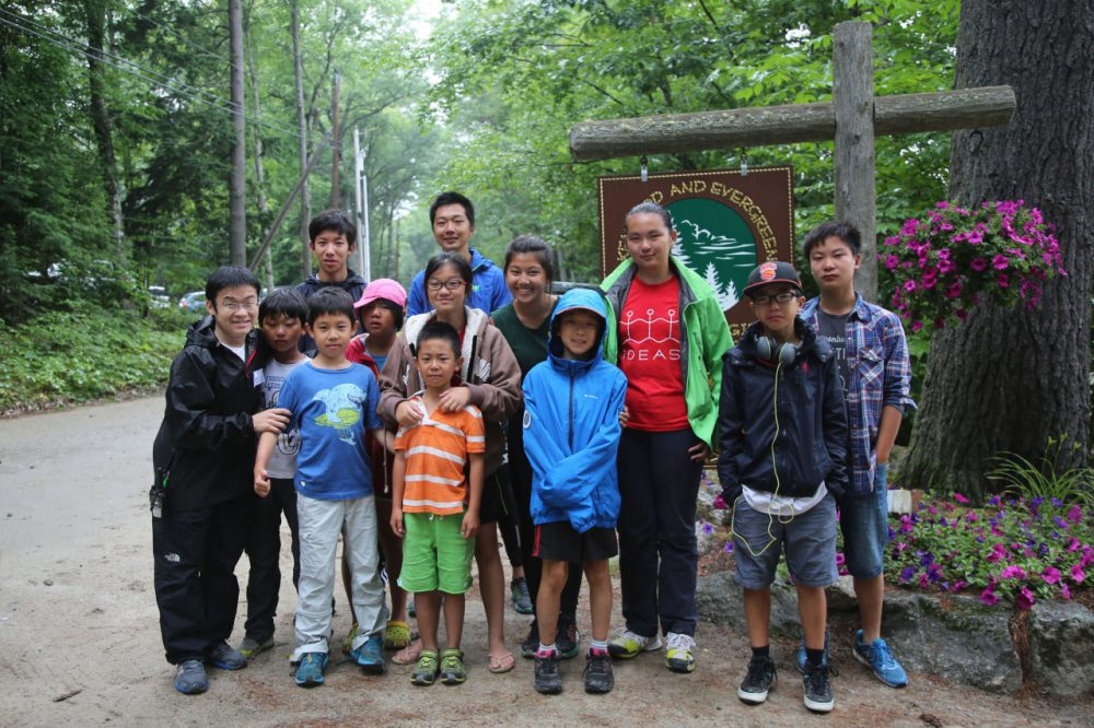 Xin Guo (left) poses for a picture with Chinese campers on the last day (there were some tears) at Camps Kenwood and Evergreen in New Hampshire this summer. (Sheila Pallay)