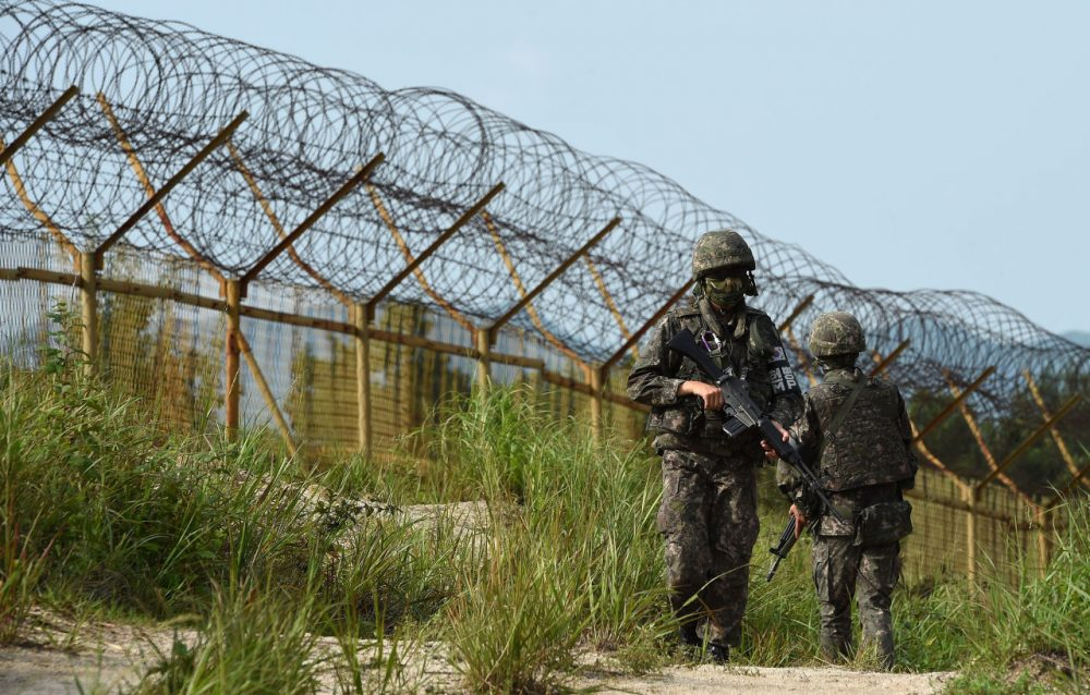 In this photo provided by the South Korean Defense Ministry on August 10, 2015, South Korean soldiers patrol near the scene where planted landmines exploded on August 4, maiming two soldiers on border patrol in the demilitarized zone dividing North and South Korea, on August 9, 2015 in Paju, South Korea. South Korea has accused North Korea of planting the landmines, sending military tensions on the Korean peninsula soaring as it threatened to make Pyongyang pay a 'harsh price.' (South Korean Defense Ministry via Getty Images)