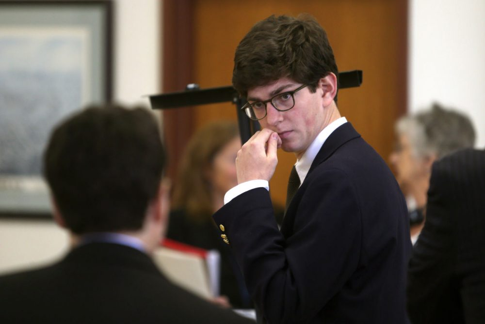 Former St. Paul's student Owen Labrie confers with his lawyer before the start of the second day of his trial at Merrimack County Superior Court in Concord, N.H., Wednesday. (Geoff Forester/The Concord Monitor/AP)