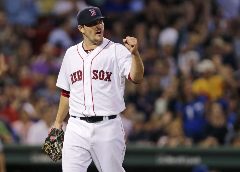 Red Sox starting pitcher Wade Miley pumps his fist after Mookie Betts snagged a line drive to end the top of the seventh inning of a game at Fenway, Thursday, Aug. 20, 2015. (Charles Krupa/AP)
