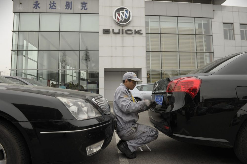 A mechanic works on a Buick at a General Motors dealership in Shanghai on December 6, 2011. (Peter Parks/AFP/Getty Images)
