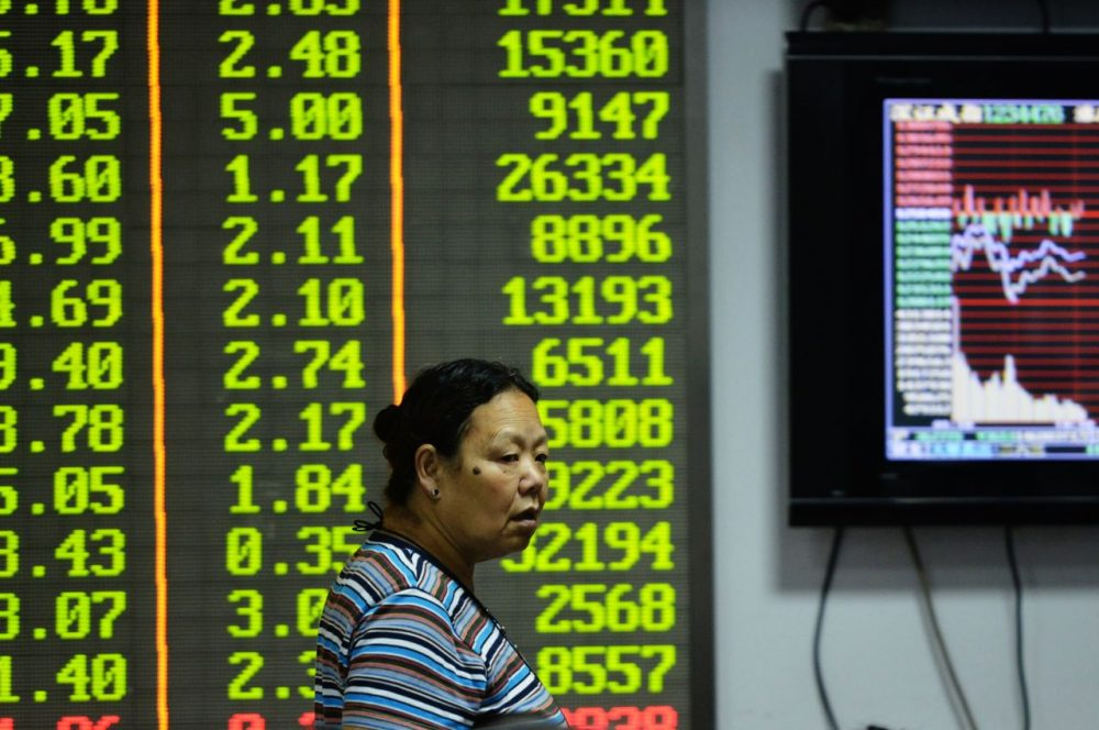 An investor observes the stock market at an exchange hall on August 21, 2015 in Hangzhou, Zhejiang Province of China. (ChinaFotoPress/Getty Images)