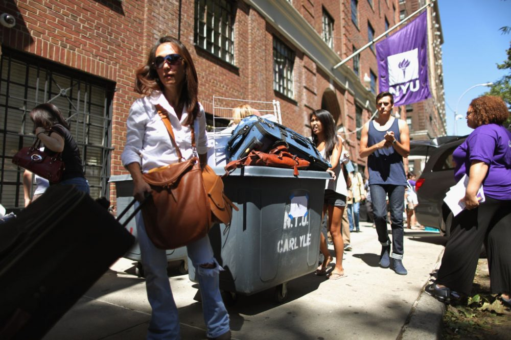 New York University freshmen students and their families fill rolling bins with their belongings as they move into their dorm rooms outside Hayden Hall August 29, 2011 in New York City. (Chip Somodevilla/Getty Images)
