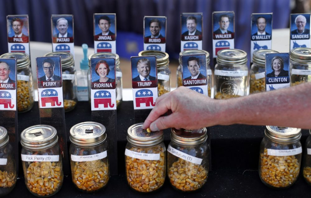 A visitor casts his vote with a kernel of corn for presidential candidate Donald Trump in a straw poll at the Iowa State Fair, Thursday, Aug. 20, 2015, in Des Moines, Iowa. (Paul Sancya/AP)