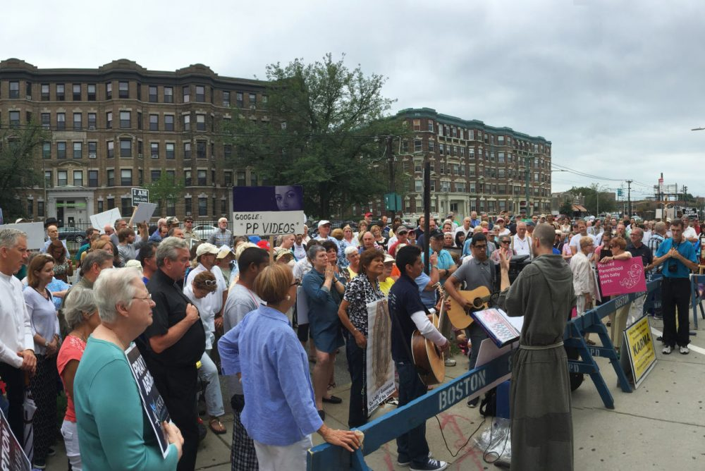 Approximately 300 people protested in front of the Planned Parenthood in Allston on Saturday. (Simón Rios/WBUR)