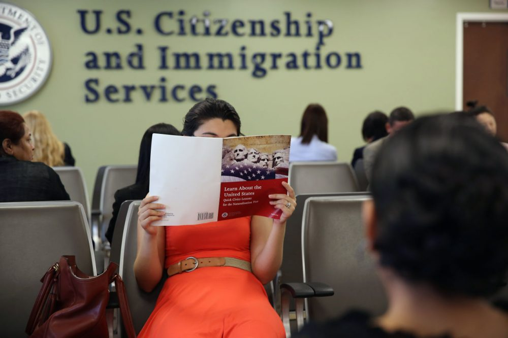 A Colombian immigrant studies ahead of her citizenship exam at the U.S. Citizenship and Immigration Services (USCIS) Queens office on May 30, 2013 in the Long Island City neighborhood of the Queens borough of New York City.   (John Moore/Getty Images)