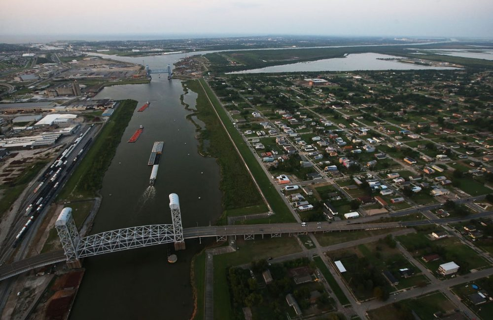 New homes are mixed with old homes and vacant lots in the Lower Ninth Ward next to ships passing on the Industrial Canal on August 24, 2015 in New Orleans, Louisiana. The area was one of the most heavily devastated areas of the city following a levee breach on the Industrial Canal during the aftermath of Hurricane Katrina. (Mario Tama/Getty Images)