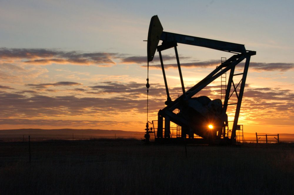 A Whiting Petroleum Co. pump jack pulls crude oil from the Bakken region of the Northern Plains near Bainville, Mont., Nov. 6, 2013. (Matthew Brown/AP)