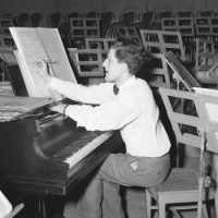 The composer Lukas Foss at 24 makes last-minute notations on the score of his symphonic work in 1947. (AP)