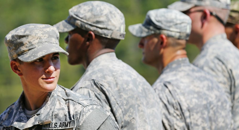Women have historically reached military milestones as soon as barriers against them were lifted. They were ready. It was the men who were not. But the tide may be turning. In this photo, U.S. Army Capt. Kristen Griest, left, of Orange, Conn., stands in formation during an Army Ranger School graduation ceremony, Friday, Aug. 21, 2015, at Fort Benning, Ga. (John Bazemore/AP)