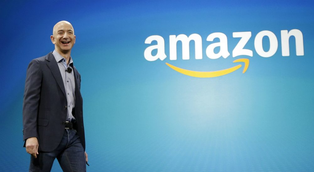 """In this June 16, 2014, file photo, Amazon CEO Jeff Bezos walks onstage for the launch of the new Amazon Fire Phone, in Seattle. A New York Times article portrayed Amazon's work culture as """"bruising"""" and """"Darwinian"""" in part because of the way it uses data to manage its staff. Amazon's CEO said in a memo to staff on Monday, Aug. 17, 2015, that the article doesn't accurately describe the company culture he knows. (Ted S. Warren/ AP)"""