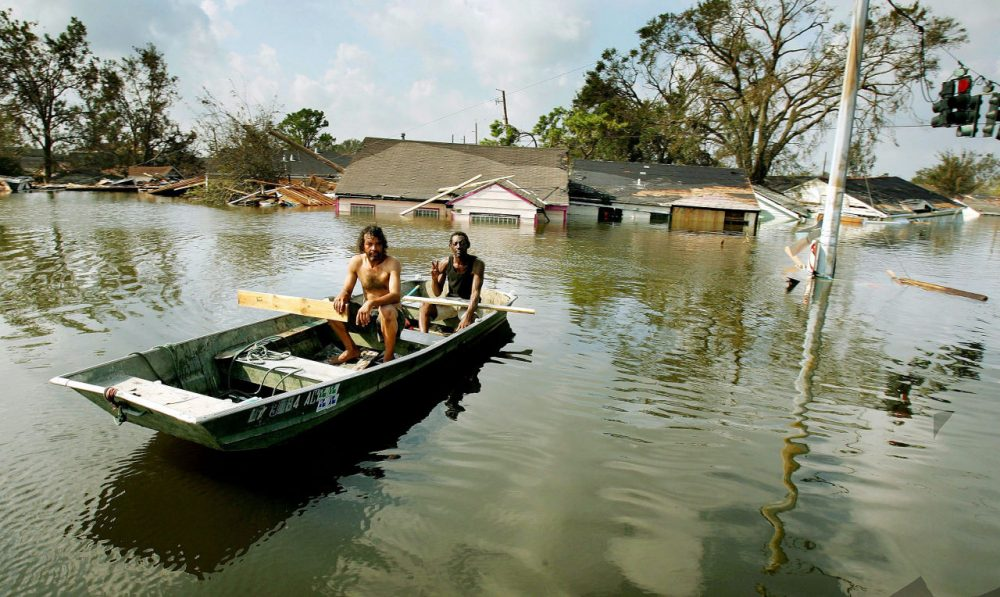 Two men paddle in high water in the Ninth Ward after Hurricane Katrina devastated the area August 31, 2005 in New Orleans, Louisiana. (Mario Tama/Getty Images)