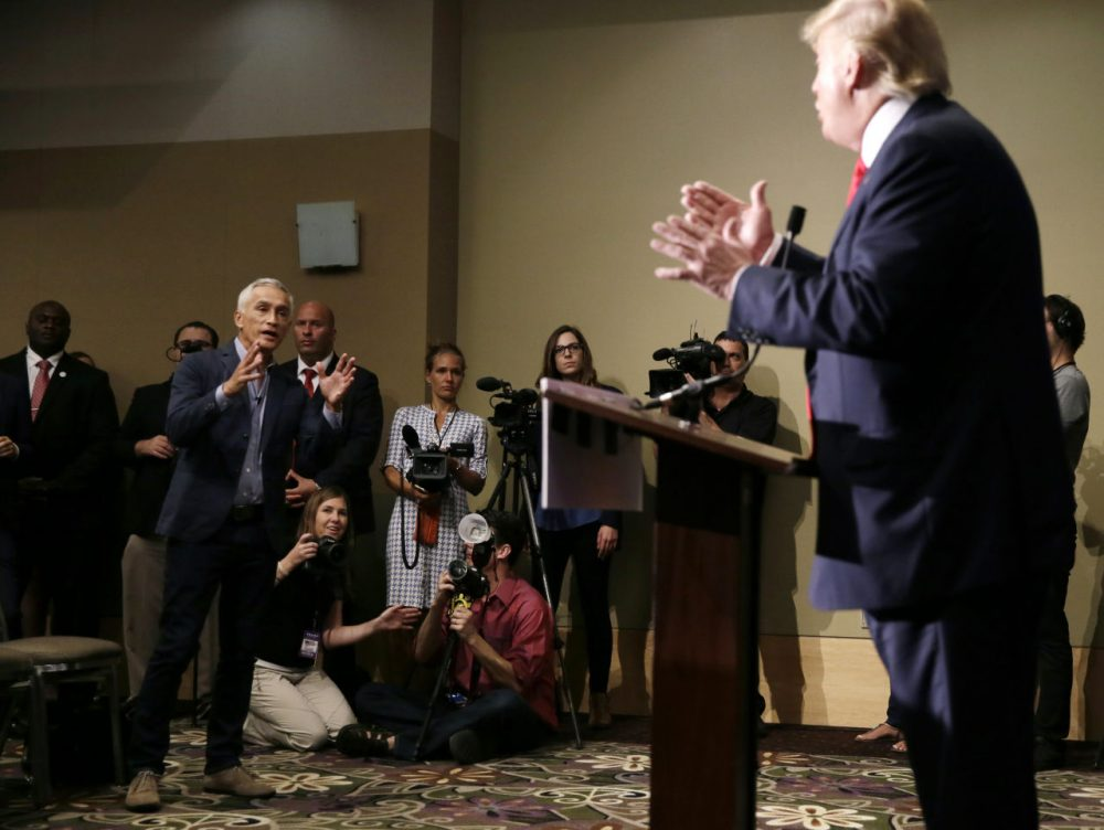 Miami-based Univision anchor Jorge Ramos, left, asks Republican presidential candidate Donald Trump a question about his immigration proposal during a news conference, Tuesday, Aug. 25, 2015, in Dubuque, Iowa. Ramos was later taken from the room. Charlie Neibergall/AP)