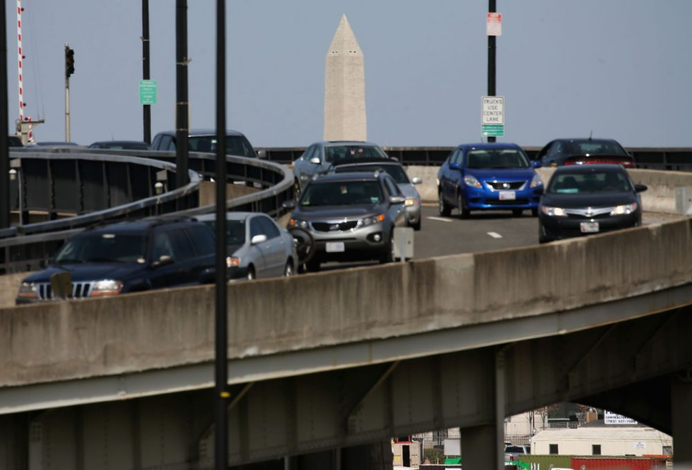 The Washington Monument can be seen as traffic travels over the Frederick Douglass Memorial Bridge, also known as the South Capitol Street bridge April 13, 2015 in Washington, D.C. (Mark Wilson/Getty Images)
