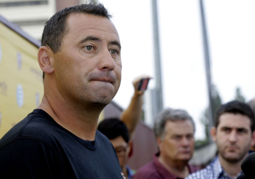 Southern California NCAA college football coach Steve Sarkisian speaks to media before football practice in Los Angeles, Tuesday, Aug. 25, 2015. Sarkisian publicly apologized for his drunken appearance at a team rally last weekend, attributing his slurred, profane speech to a combination of alcohol and medication. (Nick Ut/AP)