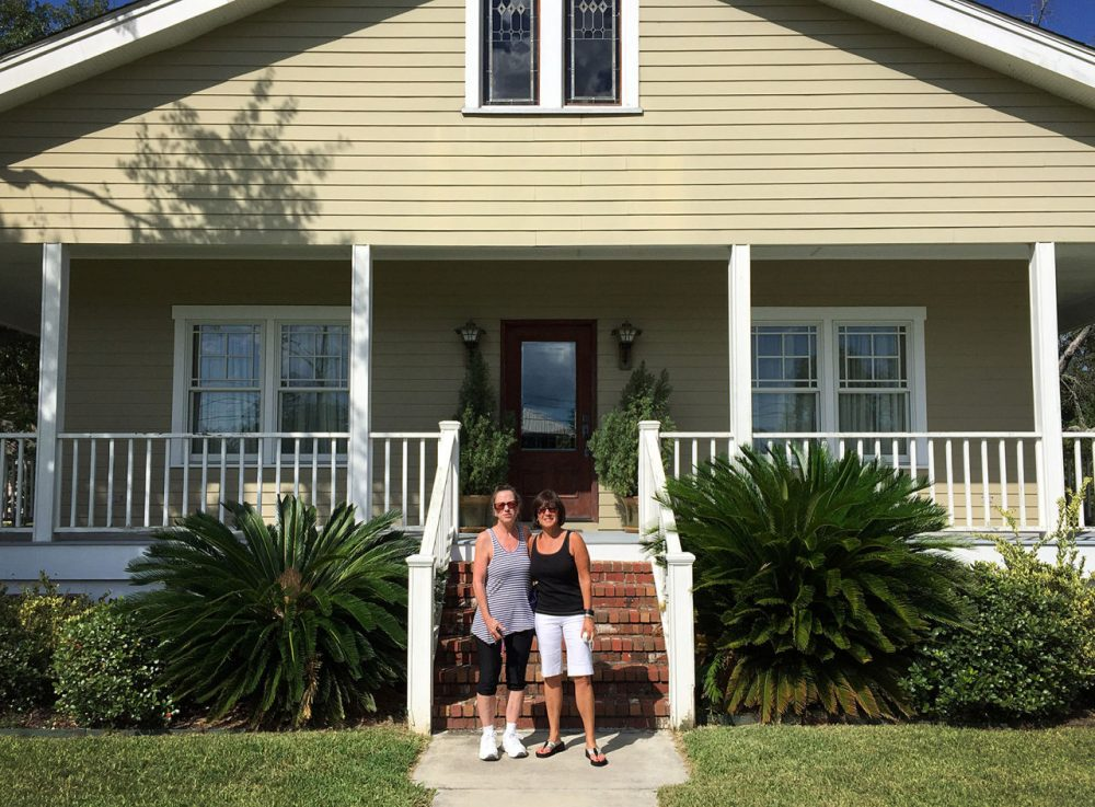 Melanie Karetas, left, of Waveland, Mississippi, and Cindy Lombardo of Wayland, Massachusetts, pose in front of Karetas' Waveland home on Saturday. The group Wayland to Waveland built the home after Hurricane Katrina, and the two have remained friends since. (Courtesy of Cindy Lombardo)