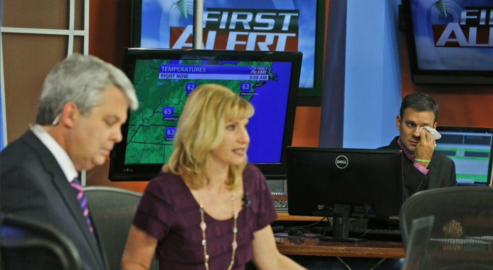 Janna Malamud Smith: The ability to amplify our worst transgressions is new, and, it seems to be a drug more potent and addictive than any other. In this photo, WDBJ meteorologist Leo Hirsbrunner, right, wipes his eyes during the early morning newscast as anchors Kimberly McBroom, center, and Steve Grant deliver the news at the station in Roanoke, Va., Thursday, Aug. 27, 2015. Reporter Alison Parker and cameraman Adam Ward were killed during a live broadcast Wednesday. (Steve Helber/ AP)