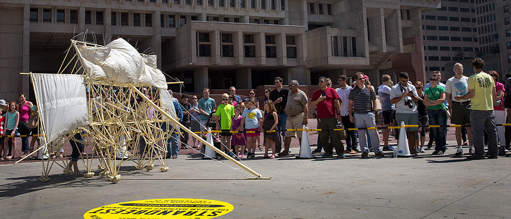 A Strandbeest walks across the Boston City Hall Plaza on Friday. (Robin Lubbock/WBUR)