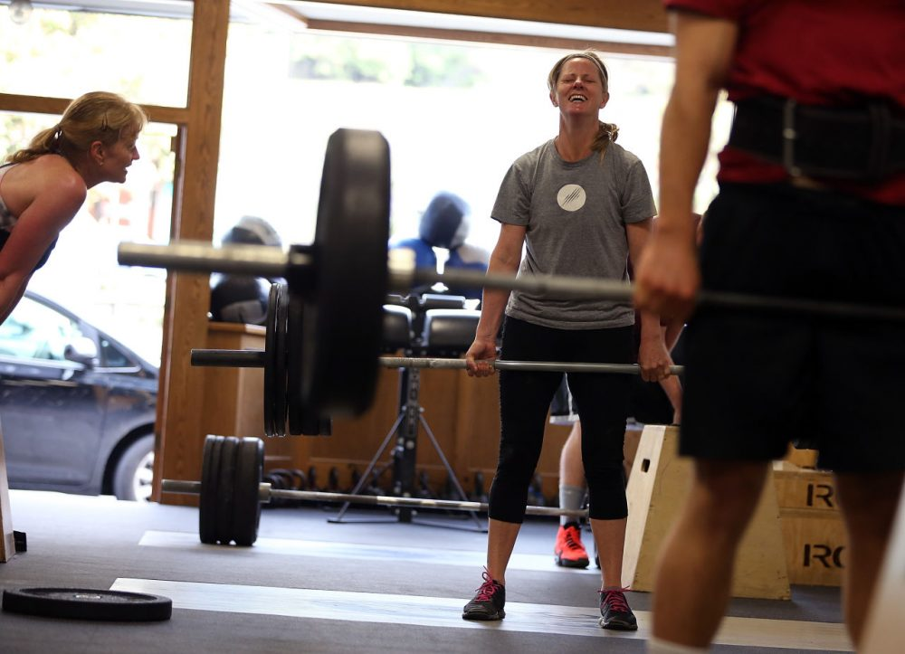 Dawn Lillington does a deadlift during a CrossFit workout at Ross Valley CrossFit on March 14, 2014 in San Anselmo, California. CrossFit, a high intensity workout regimen that is a constantly varied mix of aerobic exercise, gymnastics and Olympic weight lifting, is one of the fastest growing fitness programs in the world. The grueling cult-like core strength and conditioning program is popular with firefighters, police officers, members of the military and professional athletes. Since its inception in 2000, the number of CrossFit affiliates, or 'boxes' has skyrocketed to over 8,500 worldwide with more opening every year. (Justin Sullivan/Getty Images)