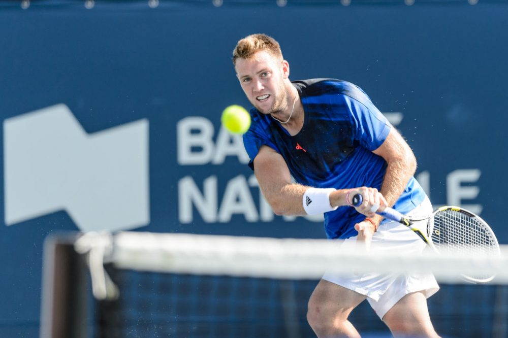 Jack Sock of the USA returns the ball against Rafael Nadal and Fernando Verdasco of Spain during day one of the Rogers Cup at Uniprix Stadium on August 10, 2015 in Montreal, Quebec, Canada. (Minas Panagiotakis/Getty Images)