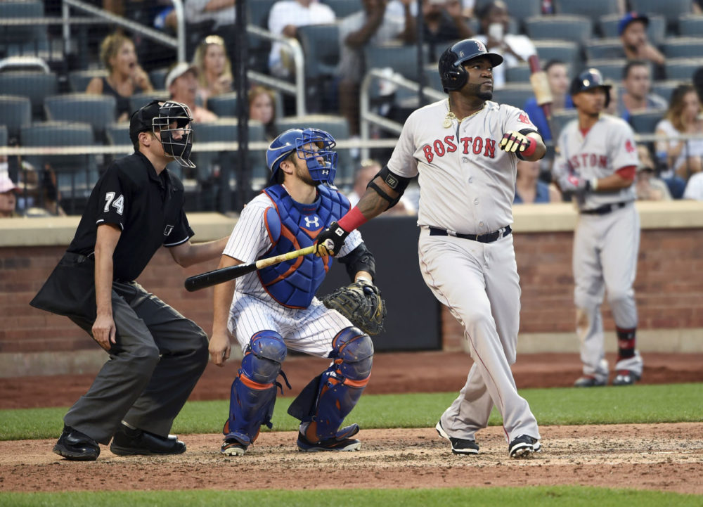 New York Mets catcher Travis d'Arnaud and Boston Red Sox's David Ortiz watch Oritz's double off of New York Mets pitcher Bartolo Colon in the ninth inning of a baseball game at Citi Field on Saturday. (Kathy Kmonicek/AP)