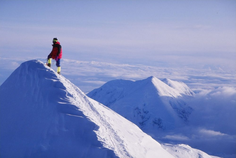 A lone climber stands on the Summit Ridge at Denali, formerly called Mount McKinley. (Mike Powell/Getty Images)