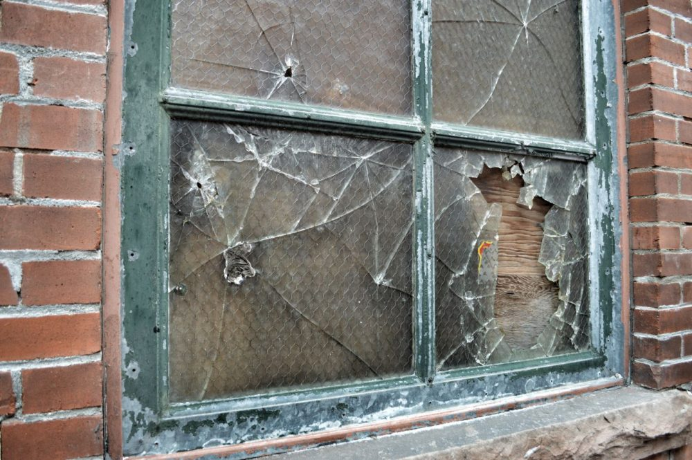 The theory of Broken Windows comes from James Q. Wilson and George Kelling, who wrote an article about the phenomenon in The Atlantic in 1982. (_scartissue/Flickr)