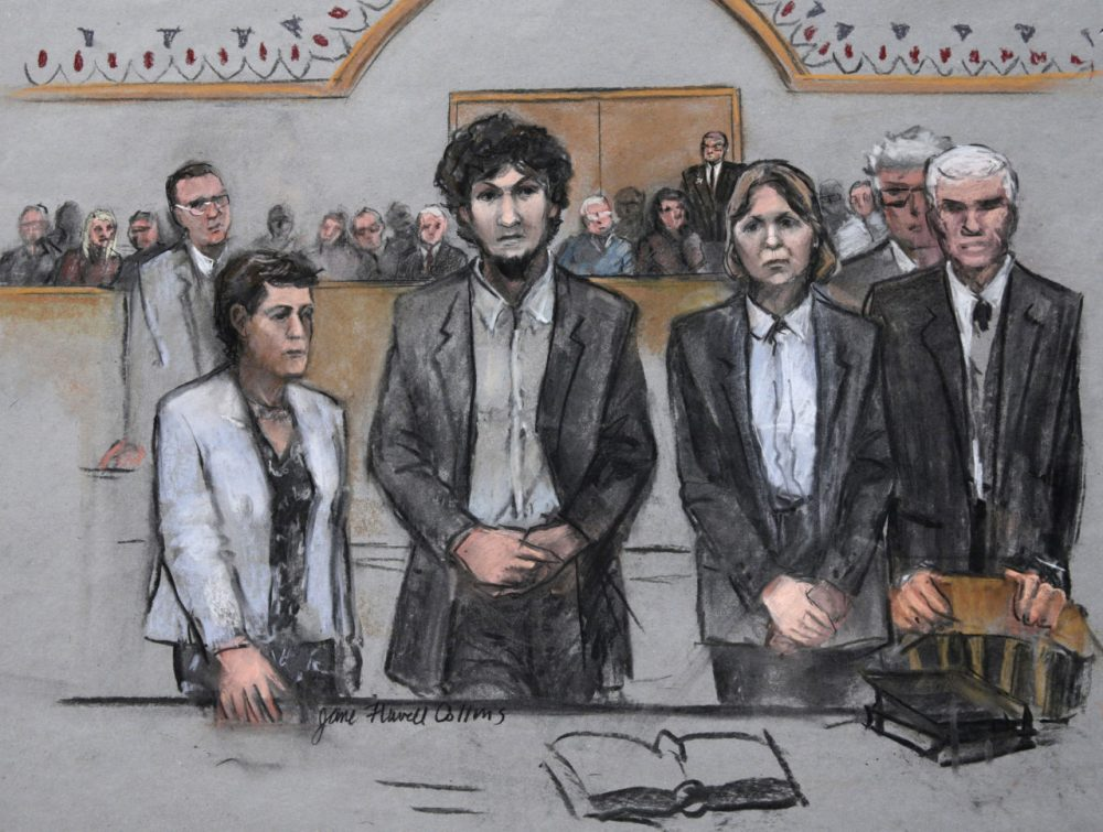 In this May 2015 courtroom sketch, Boston Marathon bomber Dzhokhar Tsarnaev (center) stood with his defense attorneys as his death sentence was read in federal court in Boston. (Jane Flavell Collins via AP)