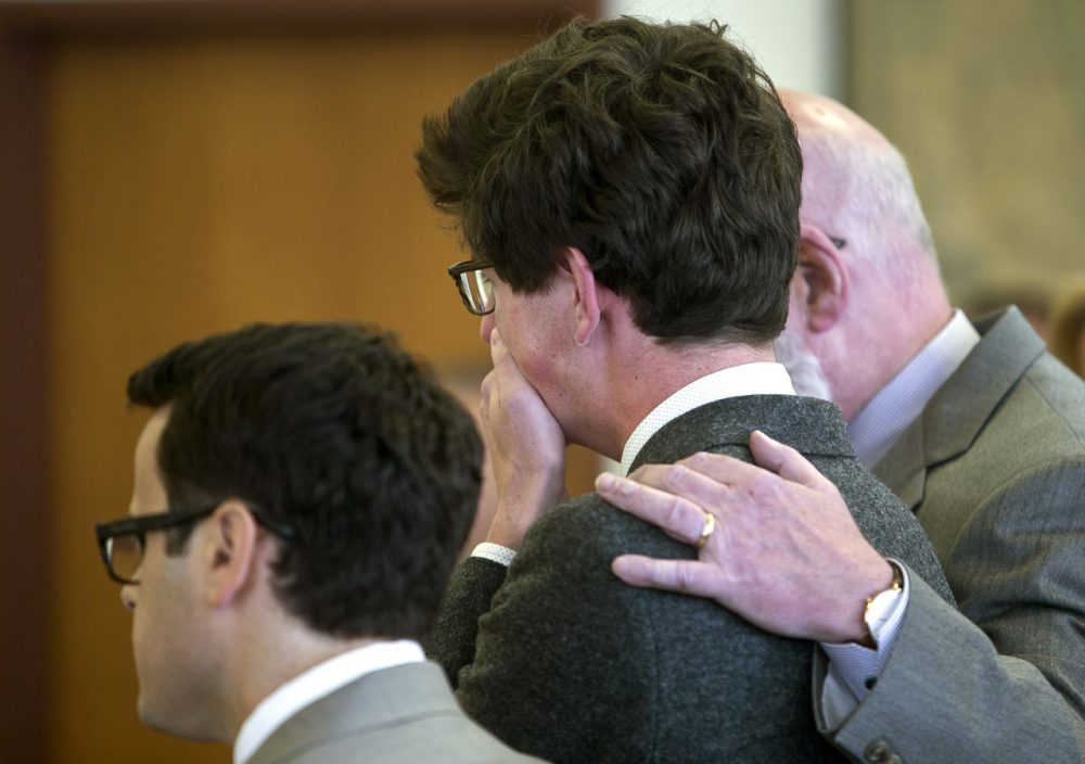 Attorney J.W. Carney puts his arm around Owen Labrie as he weeps after his verdict is read at Merrimack County Superior Court on Friday in Concord, N.H. Labrie, 19, was cleared of felony rape but convicted of misdemeanor sex offenses against a 15-year-old former classmate. (Geoff Forester/The Concord Monitor via AP)