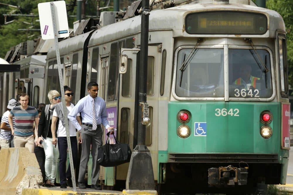 Passengers board an MBTA Green Line in Boston. (Steven Senne/AP)