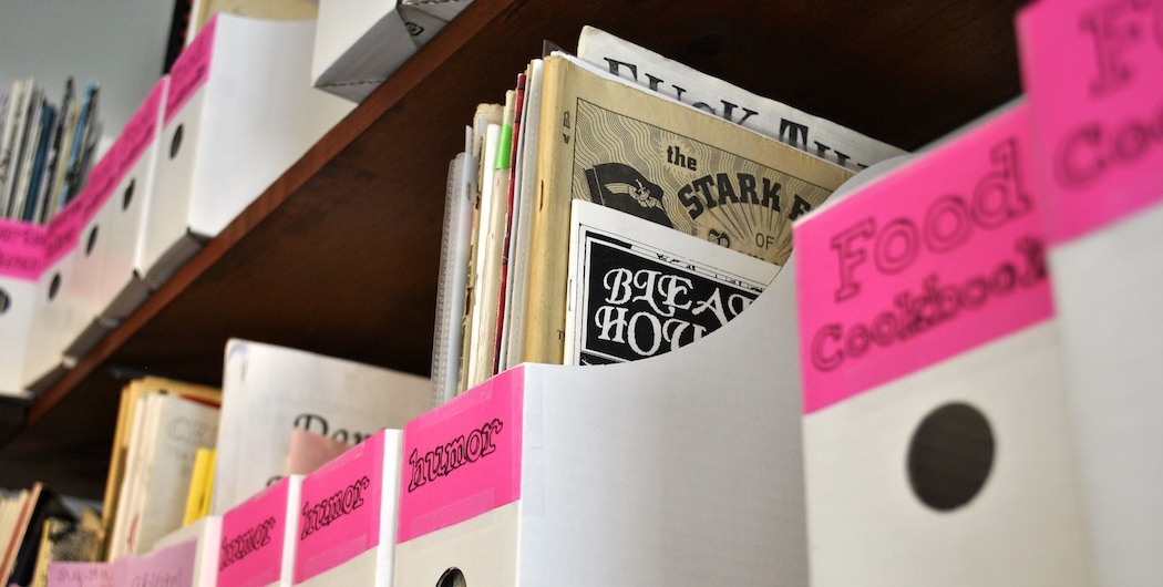 Zines on the shelf at the Papercut Zine Library (Matt Mullen for WBUR)