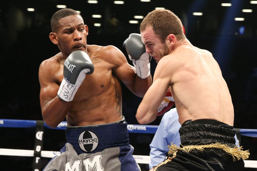 Danny Jacobs (left) has a big fight on Saturday, as he is looking to retain his middleweight title Saturday. But the biggest fight of his life came four years ago, when Jacobs had to take down cancer. (Ed Mulholland/Getty Images)