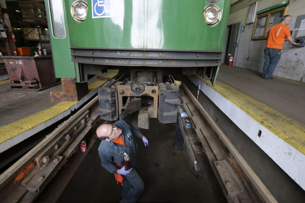 Light rail repairer Fred Goforth, of Nashua, N.H., works on a railcar coupling at the Massachusetts Bay Transportation Authority's Riverside maintenance facility in Newton, Mass. (Steven Senne/AP)