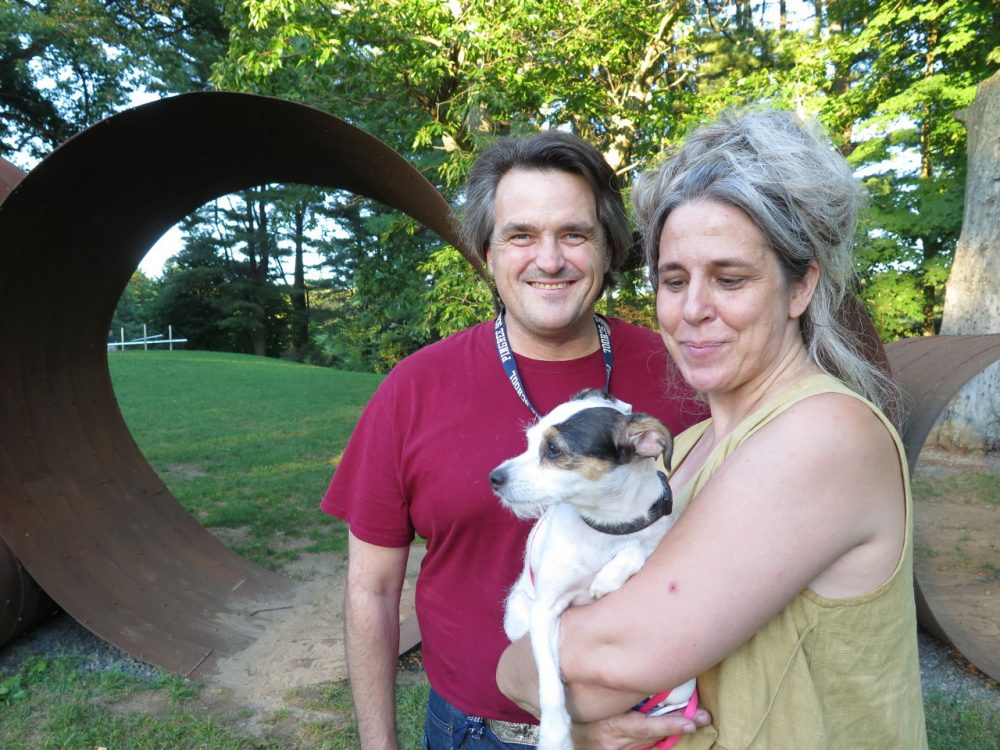 "Jason Reis with his wife Karen Krolak went on a special group walk of the deCordova Sculpture Park and Museum with their cultured Jack Russell Terrier mix, ""Quacks."" (WBUR/Andrea Shea)"