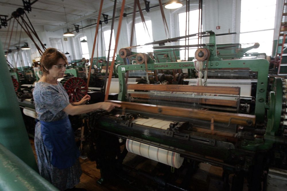 Francisca Desousa demonstrates looms at Boott Cotton Mills Museum in the Lowell National Historic Park. (Chitose Suzuki/AP)