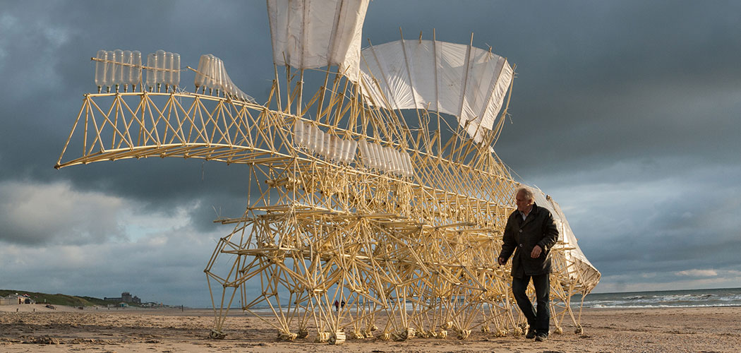 "Theo Jansen accompanies one of his walking ""Animaris Umerus' ""Strandbeests"" on the shore of Scheveningen in the Netherlands in 2009. (Loek van der Klis)"