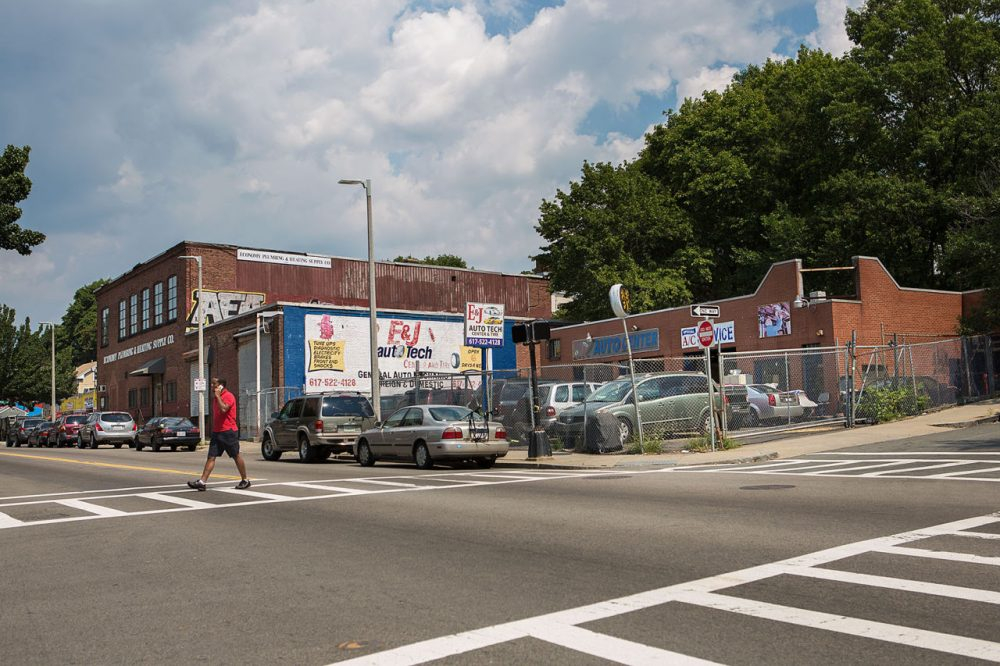 The corner of Washington and Montebello streets in Jamaica Plain is seen last month. A 76-unit development at 3200 Washington St. will replace E&J Auto Tech and an abandoned building. (Jesse Costa/WBUR)