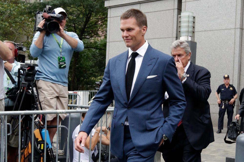 """Patriots QB Tom Brady can suit up for his team's season opener after a judge erased his four-game suspension for """"Deflategate."""" Here he is leaving federal court after a hearing on Monday. (Richard Drew/AP)"""