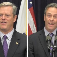 Gov. Charlie Baker, left, and Peter MacKinnon, DCF Chapter President of SEIU Local 509, speak about Baker's reforms on Monday. (Antonio Caban/State House News Service)