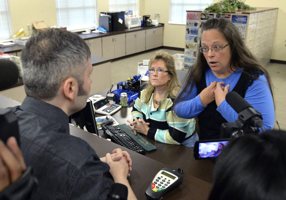 Rowan County Clerk Kim Davis, right, talks with David Moore following her office's refusal to issue marriage licenses at the Rowan County Courthouse in Morehead, Ky. on Tuesday. Although her appeal to the U.S. Supreme Court was denied, Davis still refuses to issue marriage licenses. (Timothy D. Easley/AP)