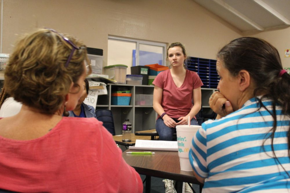 First-year teacher Rachel Foster gets advice from her veteran colleagues, including her mother Lisa. (Kyle Palmer/KCUR)