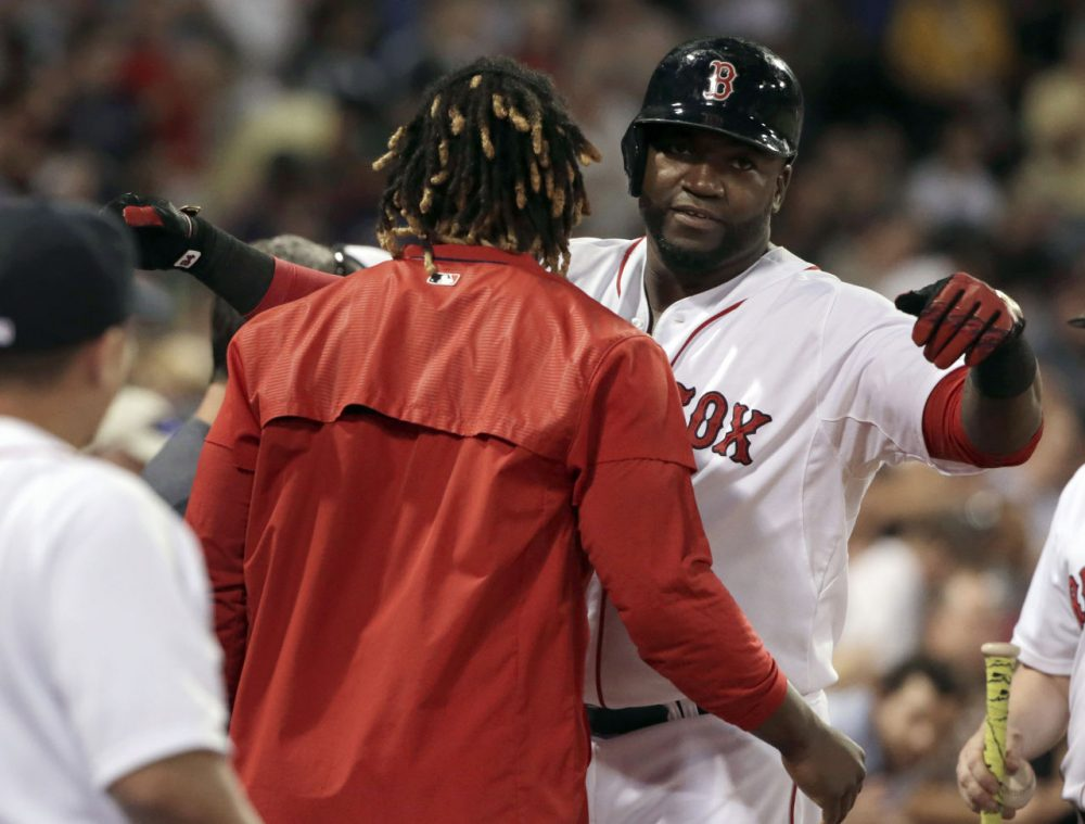 Red Sox designated hitter David Ortiz, right, hugs Hanley Ramirez after hitting a home run against the Yankees, Monday, Aug. 31, 2015, at Fenway. The Red Sox won 4-3. (Steven Senne/AP)