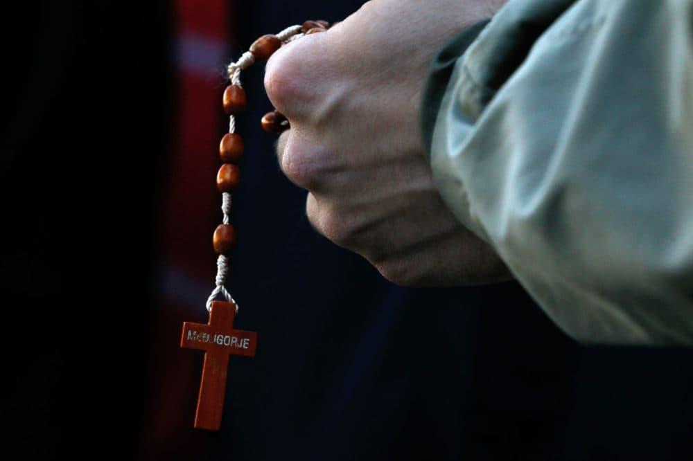 A man holds rosary beads, Saturday, Jan. 24, 2015, in Baton Rouge, La. (Jonathan Bachman/AP)