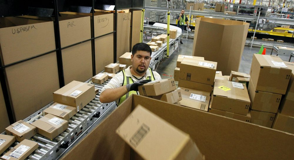 Compared to mistreated workers at under-the-radar small businesses, it can be argued that the threat of bad publicity insulates some corporate employees. In this Nov. 11, 2010 file photo, Ricardo Sandoval places packages in the right shipping boxes at an Amazon.com fulfillment center, in Phoenix. (Ross D. Franklin/ AP)