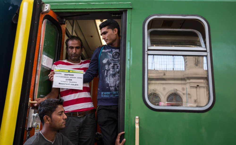 Migrants board a train in Keleti station heading for the border town of Sopron after it was reopened this morning in central Budapest on September 3, 2015 in Budapest, Hungary. Although the station has reopened, all international trains to Western Europe have been cancelled. (Matt Cardy/Getty Images)
